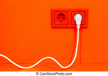 Electric plug - Bright orange wall with European electric...