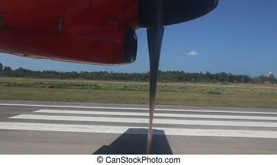 rotating aircraft engine propeller on runway - rotating...