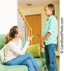 Mother and son after quarrel - Mature mother and teen son...