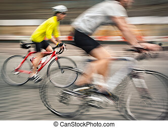 Two men ride bicycles on the streets of the big city....