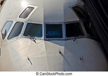 Commercial Aircraft - A commercial aircraft at an airport at...