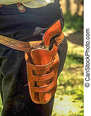Holstered pistol - Relvolver holstered in a brown leather...