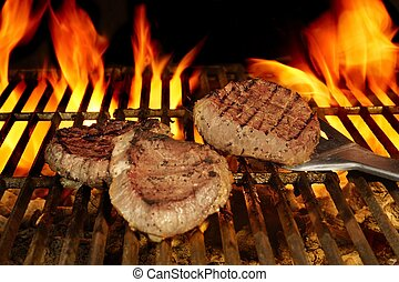 Beefsteaks on the Flaming Grill - Three Beefsteaks on Hot...