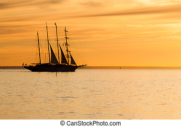 Old sail ship silhouette in sunset - Old tall sail ship...