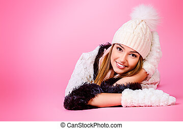 careless - Joyful girl in warm knitted clothing smiling at...