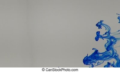 Blue, green, yellow and red ink in water abstract background...