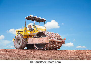 Equipment - Compaction equipment with clear sky background.