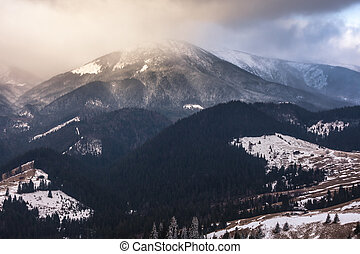 Sunset in winter mountains with dramatic light.