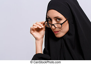 Beautiful Muslim woman looking at camera - Education in...