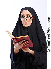 Beautiful Muslim woman holding a book - Looking forward to...