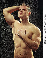 Handsome young man taking a shower - Handsome in a shower....
