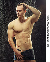 Handsome young man taking a shower - Too hot to handle. Side...
