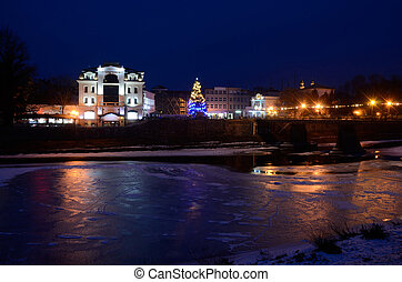 Night view of frozen Uzh river, Uzhgorod,winter time,...