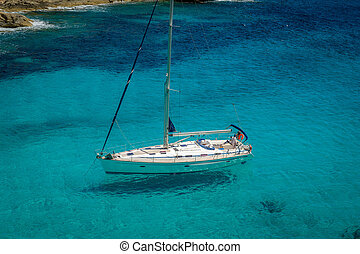 Sailing yacht stays at beautiful water bay with clearly seen...