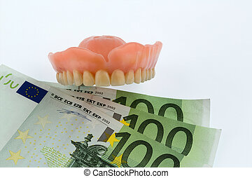 teeth and euro bills symbolic photo for dentures, treatment...