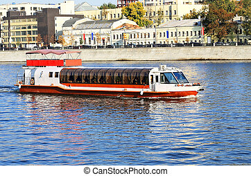 Waterbus - Pleasure boat on the river on a summer evening