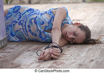 unconscious kidnapped woman - model playing a unconscious...