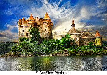 fairy castle on lake over sunset - chateau de Val, France