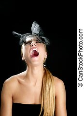 Blond fashion woman with scream shout expression over black