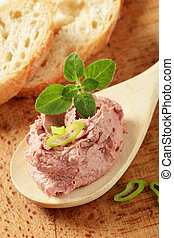 Liver mousse - Liver pate on a wooden spoon and slices of...