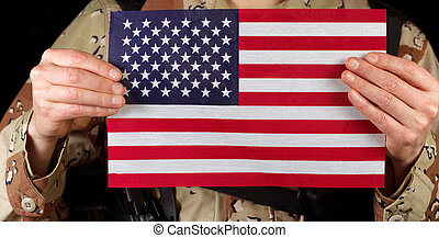 American flag being held by male soldier - Close up...
