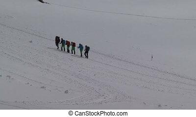 climbing a mountain - climbers group. climbing a mountain.