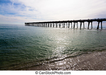 Pensacola pier with sun shining through - The Pensacole pier...