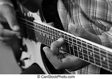 close up guitar ,play music concept - close up guitar ,hand...