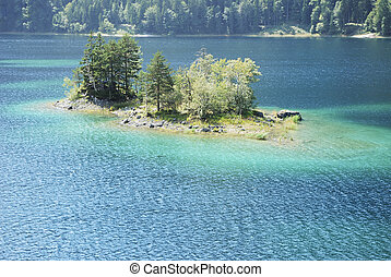 Eibsee Island - Island in lake Eibsee in Germany (Bavaria)...