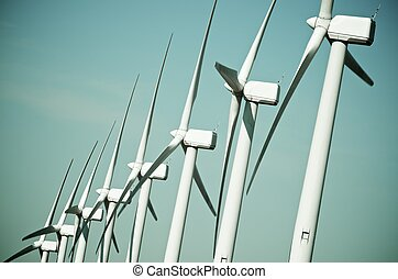 wind turbines - aligned group of windmills for renewable...