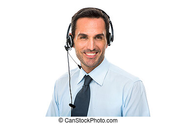 Portrait of a smiling man with headset working as a call...
