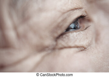 Senior man - Close-up view on the eye of elderly human