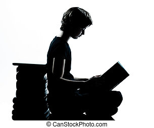 one caucasian young teenager silhouette boy or girl reading