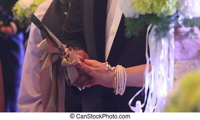 bride and groom holds knife cut wedding cake - a bride and a...