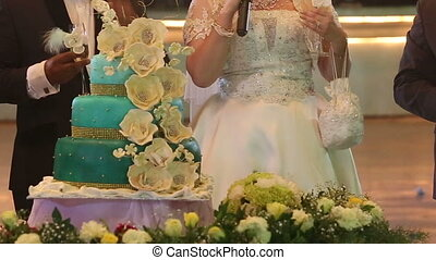 bride talking on wicrophone near wedding cake - european...