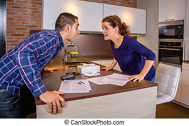 Angry couple shouting in a hard quarrel by debts