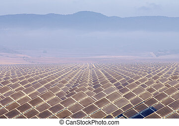 solar energy - huge solar field in the morning