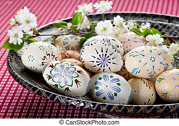 Easter eggs with blossom on the table