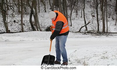 Worker on sidewalk with back pain in winter