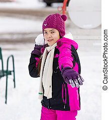 cute girl throwing snowball at camera - Portrait of cute...