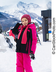 smiling girl throwing snowball at highland resort - Cute...