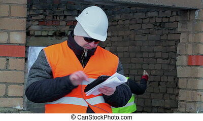 Construction foreman working with tablet PC