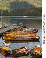 boats on the lake - boats in a line on the dock