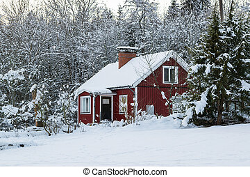Red wooden house in Sweden in winte - Old swedish farmhouse...