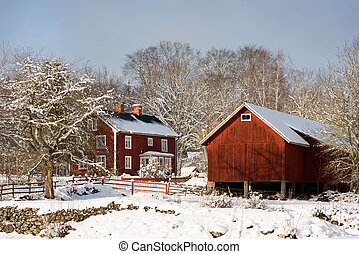In a winter wonderland - Old swedish farm buildings in the...