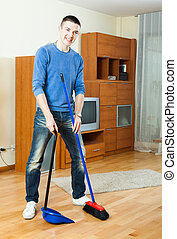man  cleaning  in living room