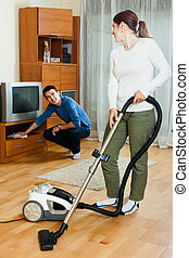 Happy couple doing housework together - Happy adult couple...