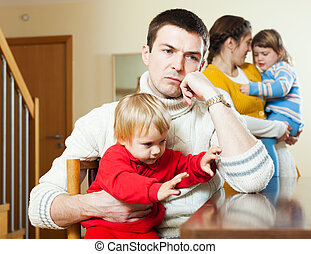 Family of four having quarrel at home - Family of four with...