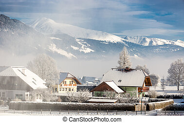 traditional Austrian town in mountains covered by snow -...