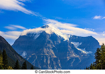 Mount Robson, the highest point in the Canadian Rockies,...